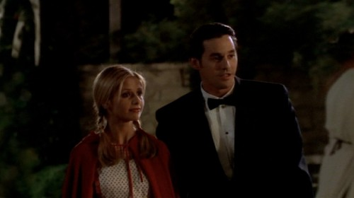 Buffy as Little Red Riding Hood and Xander as James Bond