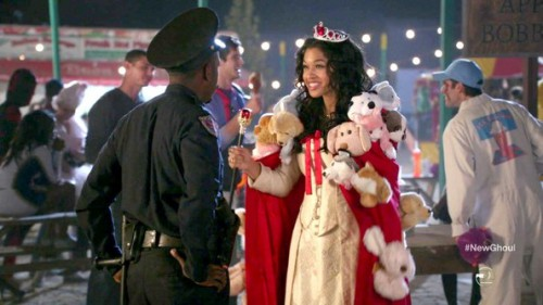 Winston as a cop and Shelby as reigning cats and dogs